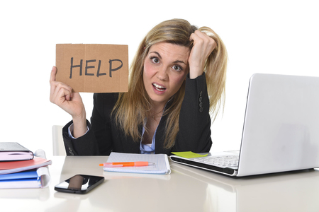 Photo for young beautiful business woman suffering stress working at office computer desk asking for help feeling tired and desperate looking overworked overwhelmed and frustrated - Royalty Free Image