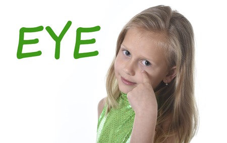 Photo pour 6 or 7 years old little girl with blond hair and blue eyes smiling happy posing isolated on white background pointing eye  in learning English language school education body parts card set - image libre de droit