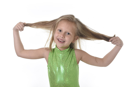 Photo pour 6 or 7 years old little girl with blue eyes smiling happy posing isolated on white background pulling her blond hair in language lesson for child education and body parts school chart serie - image libre de droit