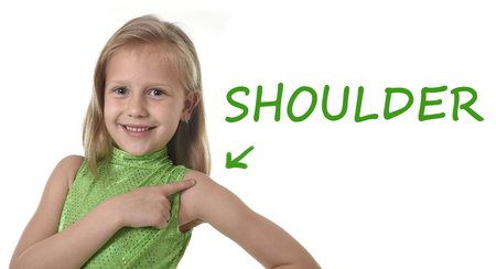 Photo pour 6 or 7 years old little girl with blond hair and blue eyes smiling happy posing isolated on white background pointing shoulder in learning English language school education body parts card set - image libre de droit