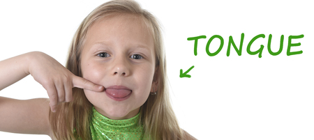 Photo pour 6 or 7 years old little girl with blond hair and blue eyes smiling happy posing isolated on white background pointing tongue in learning English language school education body parts card set - image libre de droit