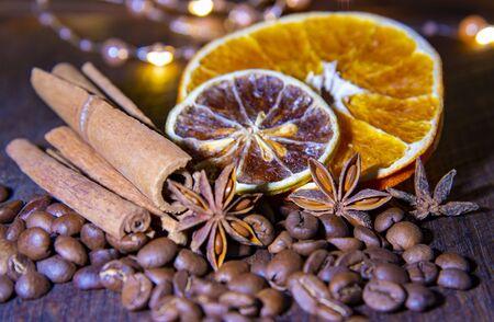 Photo pour Coffee beans with citrus cinnamon sticks and star anise on wooden surfaces. - image libre de droit