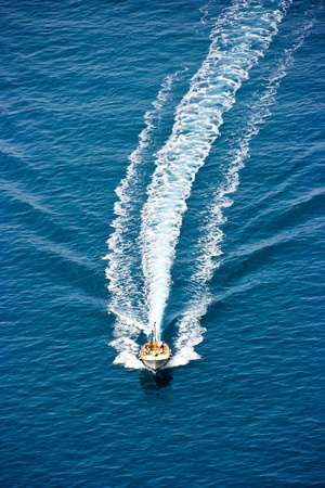 People on the boat racing on the water