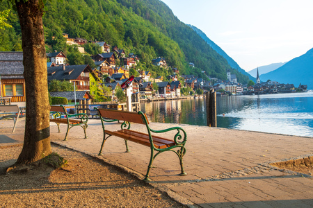 View of the Alpine town of Hallstatt on the shore of a mountain lake at dawn