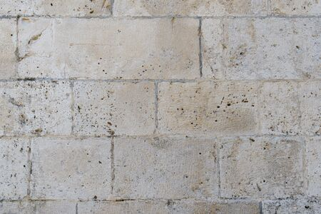 Photo pour Fragment of an old stone wall of an ancient Roman temple made of processed sandstone. Background. Gray. - image libre de droit