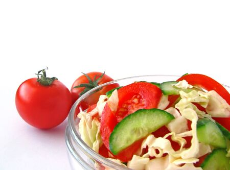 Fresh vegetable salad with tomato and cucumber isolated on white background
