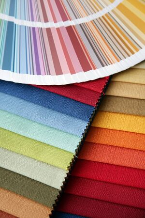 samples of a fabric and opened color card with various colors