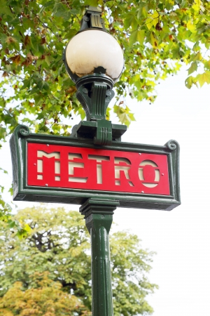 sign metro station on the street of Paris