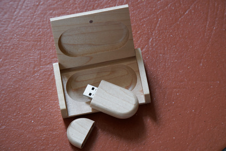 Usb flash drive with wooden surface in wooden box on desk for USB port plug-in computer laptop for transfer data and backup business concept.