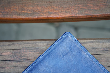 Notebook on bench in park, business concept.