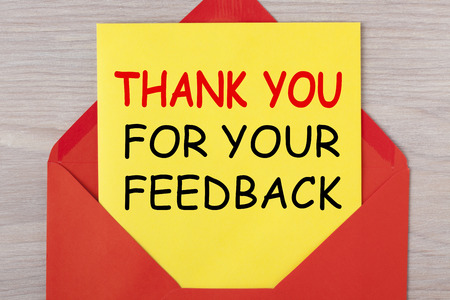 Thank you for your feedback written on letter in red envelope. Business concept.
