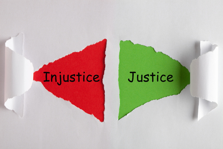 Justice and Injustice words on white torn paper with triangle shape. Business concept
