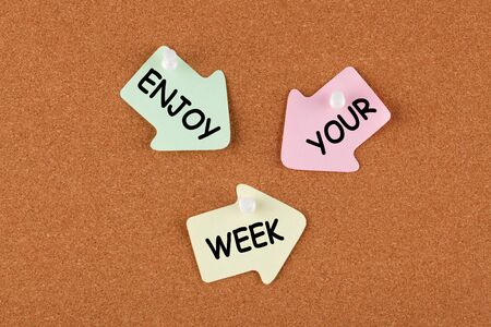 Photo pour Enjoy Your Week text on color reminder notes with pin on cork board. Business concept   - image libre de droit