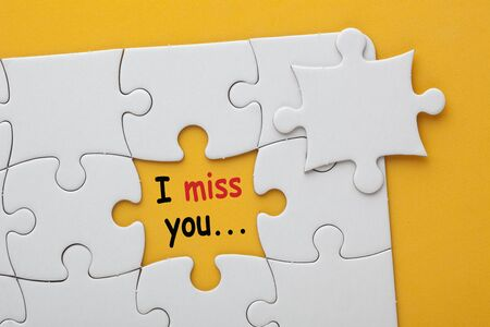 Photo for Missing jigsaw puzzle piece with text I miss you  - Royalty Free Image