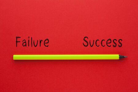 Photo pour The words success vs failure and pencil on red background. Business concept. - image libre de droit
