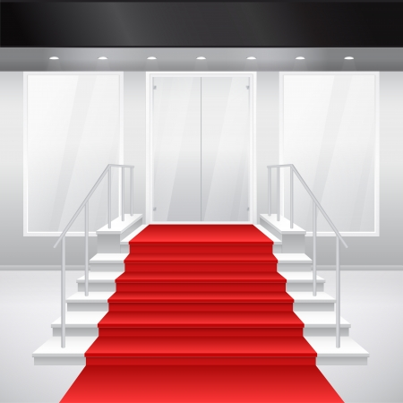 Entry to shop with stairs and red carpet. of entrance to building. Exterior of store in gray color