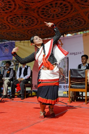 KATHMANDU, NEPAL - MAY 17, 2014: Nepali  girl dancer performing traditional Nepal dance called Hijo Rati Sapani Ma Nepali Dance in Kathmandu. Legends state that dances in the Indian subcontinent originated in the abode of Lord Shiva the Himalayas and the