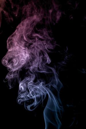 Photo pour colorful smoke on dark background - image libre de droit