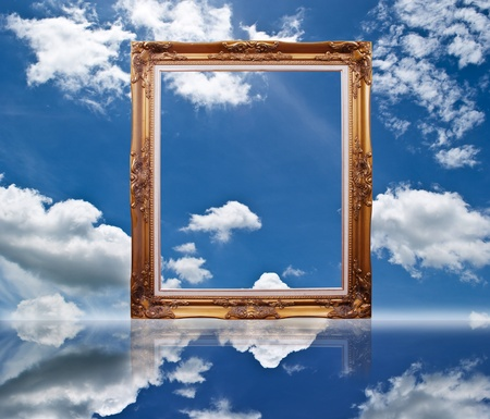 Photo frame on the blue sky field.