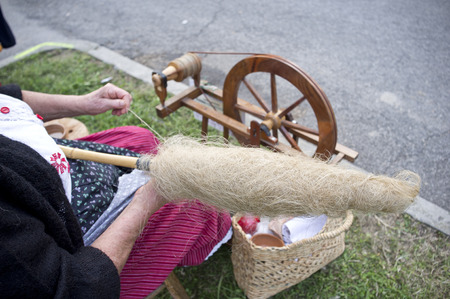 expert hands of the craftsman elderly spinning yarn