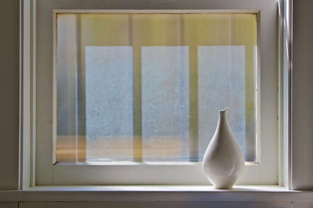 Vase by the window with soft morning light