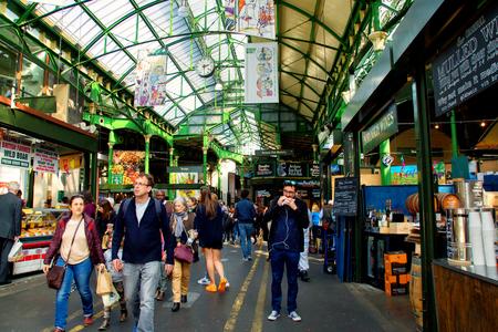 UK, London - April 08, 2015: Unidentified people visit Borough Market in London