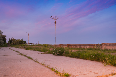 Photo for Old abandoned sea promenade with lanterns beautiful evening sky background - Royalty Free Image