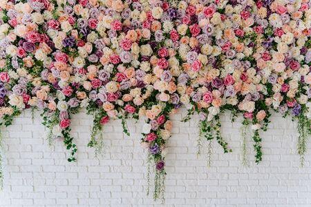 Foto de Beautiful Decorative Colorful Roses on Brick Wall - Imagen libre de derechos