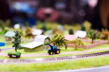 Miniature tractor loads a haystack.