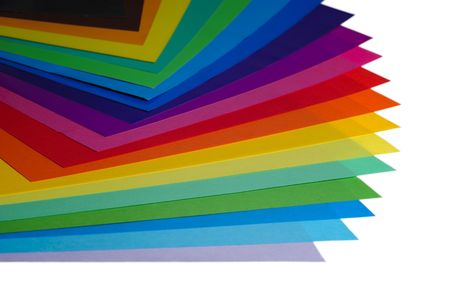 various color paper stack like a rainbow isolated on white