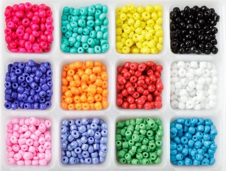 close up multi colored beads heap in box