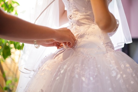 Wedding lacing with hands close up