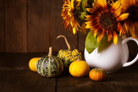 Still life with decorative pumpkins on wood background