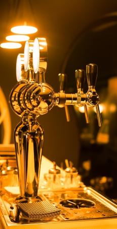 Foto de Beer taps in a bar for spilling drinks - Imagen libre de derechos