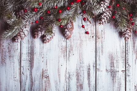 Photo for White shabby Christmas border with snow covered pinecones - Royalty Free Image