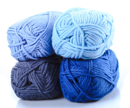 A ball of blue woolen yarn close-up. Background