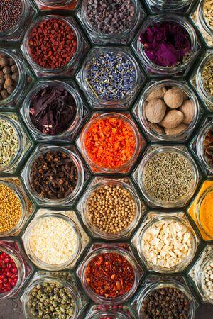 Foto für Assorted colorful spices and herbs in bottles, top view - Lizenzfreies Bild