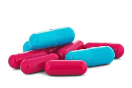Photo pour Pile of medical pills in red and blue colors on white isolated background with shadow. - image libre de droit