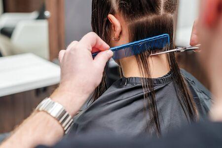 Foto für Hairdresser cuts hair of woman in hair salon close up. - Lizenzfreies Bild