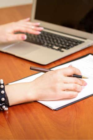 Foto de Female working with the documents - Imagen libre de derechos
