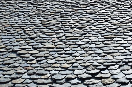 Traditional old tiled roof is made from locally available materials such as slate.