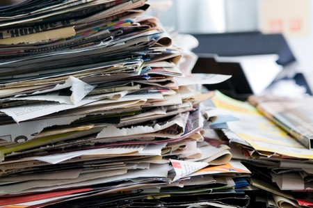 Pile of old newspapers ready for recycling