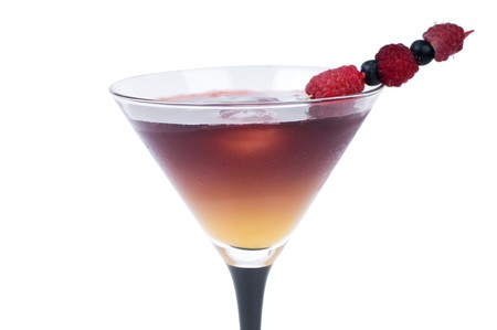 Cocktail with ice and fresh Berries, it is isolated on a white background.