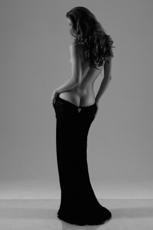 Beautiful silhouette of a woman with bare back