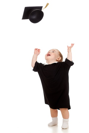 Baby in academician clothes  tossing up academical cap