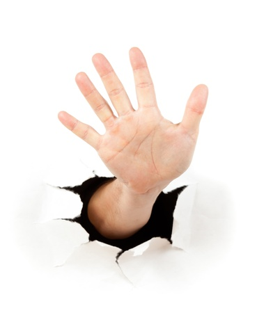 Photo for Hand through a hole in paper - Royalty Free Image