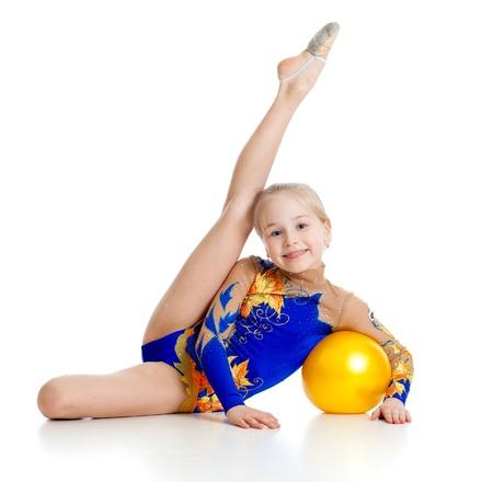 pretty girl gymnast with yellow ball