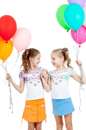 Two girls  with colorful ballons in hands  Isolated on white