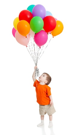 Photo for Smiling baby boy  with bunch of colorful ballons in his hand  Isolated on white  - Royalty Free Image