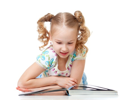cute happy kid reading a book